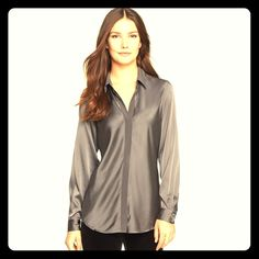 EILEEN FISHER dark gray/platinum silk blouse They won't be able to resist rubbing their hands on your shirt! This classic staple has been sadly neglected on my closet - only worn for picture! Long arms and long length give it ultra chic look. Wonderfully comfortable. Gorgeous tucked into toght, black pencil skirt with heels - or untucked with white skinny jeans! Versatile. Eileen Fisher Tops Blouses