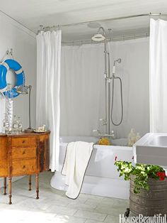 Nautical Bathroom: Marbleized paper — Pheasant by Twigs — and a 1940s French metal mirror complement a New York apartment's powder room's vintage marble sink and antique fixtures designed by Todd Klein.