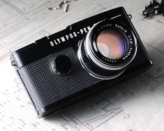 Olympus Pen FT with link to history.