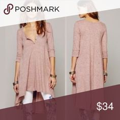 """Heathered Pink Hi-Low Henley Tunic DRESS Flowy Heathered Pink Tunic Dress with Henley-Style Scoop Neckline, three-quarter sleeves, and high-low hem. Similar style by Free People.    Item is Brand New, direct from the Manufacturer, & sealed in package!!   Available in Sizes: S, M, & L Length: S: 32-42"""" / M: 33-43"""" / L: 34-44"""" Dresses Long Sleeve"""