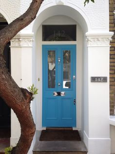 A lovely, vibrant Voysey & Jones front door painted with Farrow & Ball's St. Giles Blue.