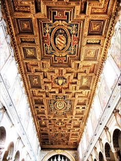 Gilded wooden ceiling (1572-1575) with coat-of-arms of pope Pius V - Santa Maria Aracoeli Church in Rome by Carlo Raso