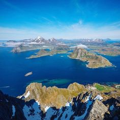 The crystal blue arctic waters surrounding the Lofoten islands looks extra stunning from the summit of one of the 800 meter peaks.  One day I need to spend some time in a wetsuit in these waters my tolerance for the cold water only lasted about 4 minutes without one!  #wheretowillie