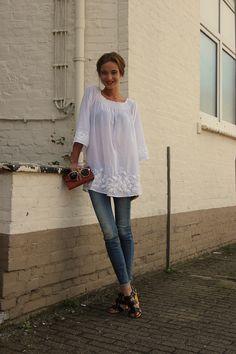 Zara blouse, Zara jeans, Dolce & Gabbana heels, Uterque wallet, Yves Saint Laurent ring.