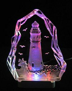 Engraved lead crystal Lighthouse - boat on LED color light base  It is easy to find the perfect gift for lighthouse lovers when you know they love lighthouse home décor and accents that make them think of lighthouses.  Lighthouses are nostalgic, historic and adorable which is a great reason to find inspiration by this type of sea side home décor.   Lighthouse home décor can be used in any room of the home and is the perfect theme to center your home decoration around.