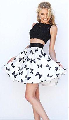 1aae1175b5d Amazon.com  Cute Bowknot Print Mini Skirt Flared Pleated Short Skirt for  Women Girls  Clothing