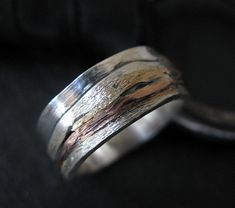 The design of this unique band is Sedona and the San Francisco peaks. I used layers of silver, yellow and red gold to depict this beautiful scenery. It is a size 7 1/2 and there is only 1 available. Please convo us if you would like a similar ring made in your size.  You receive the ring in the photographs in a gift box with a Hot Rox pouch. A generous percentage of this sale is donated to Our House of Hope K-9 Rescue in Libertyville, Illinois.  Design Specifications .925 Sterling silver 8mm…