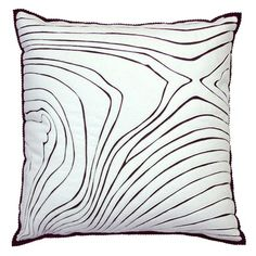 Another great statement piece that is easily duplicated on a budget with cheap pillow and fabric paint markers.  Use a bold color for extra impact