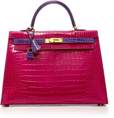 Heritage Auctions Special Collections Herms 35cm Rose Shocking & Ultraviolet Porosus Crocodile Sellier Kelly by MODA OPERANDI  Heritage Auctions Special Collections Herms 35cm Rose Shocking & Ultraviolet Porosus Crocodile Sellier Kelly by MODA OPERANDI  Available Colors: Pink  Available Sizes: OS  DetailsThis Herms Kelly brought to you by Heritage Auctions Special Collections is rendered in porosus crocodile Herms' most luxurious skin and features contrasting details and gold hardware.