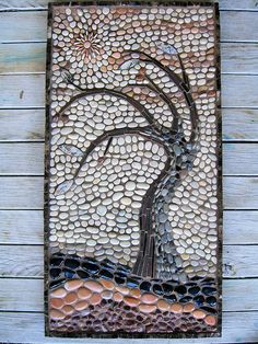Mosaic tree made from pebbles.
