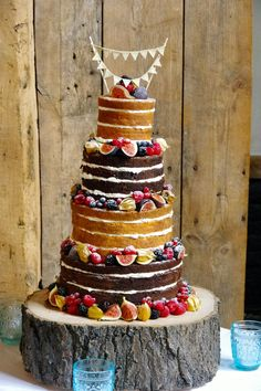 4 tier naked cake with chocolate and sponge, decorated with tropical fruits and…