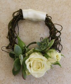 a wreath corsage - cluster roses, dodder vine and mini succulents