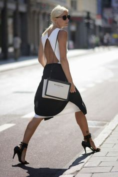 The most stylish way to work a black and white look, with a cut-out back and strappy heels.