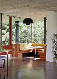Dining Room Idea - Create A Built-In Dining Nook (8 Pictures) | Windows surrounding this built in dining area ensure that everyone at the table has incredible views of the rainforest outside. Upholstered cushions have been designed to match the dimensions of the benches.