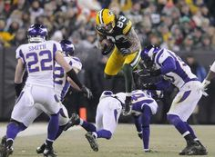 Green Bay Packers tight end Tom Crabtree (83) leaps a host of tacklers in the third quarter against the Minnesota Vikings during Saturday night's NFC wild-card playoff game at Lambeau Field. Photo by Evan Siegle/Press-Gazette Media