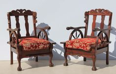 2 Vintage Carved Imbuia Ball and Claw Wagon Wheel Lounge Chairs Condition:  Used  2 Vintage Carved Imbuia Ball and Claw Wagon Wheel Lounge Chairs  size per chair: 670 L x 600 W x 910 H  R3999 for the two chairs  Cell 076 706 4700  Tel 021 - 558 7546  www.furnicape.co.za