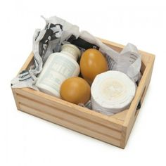 A crate of painted wooden dairy produce including a milk bottle with a removable lid, a wheel of cheese and eggs.  The crate is scaled to the Honeybee Market - sold separately.