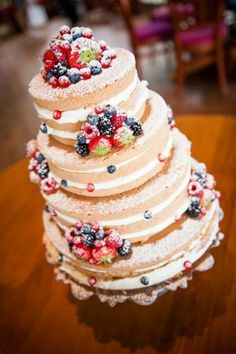 Wedding cake with a lot of fresh fruit