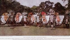 1900's Zulu Ricksha Pullers in Durban, South Africa:  The uniquely South African phenomenon of elaborately decorated Ricksha pullers caught the eye of National Geographic Magazine.  At the same time, the Encyclopaedia Britannica referred to 'Ricksha Boys' as a Durban tourist attraction to the outside world.