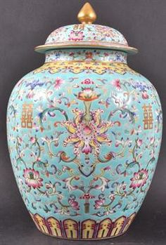 A FINE CHINESE FAMILLE ROSE TURQUOISE GROUND OVOID JAR AND COVER Daoguang mark and period, enameled with elaborate foliage and pomegranate, surrounding Shou characters