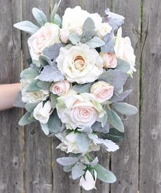 This bouquet is made with blush peachy-pink roses, champagne roses, dusty miller and lambs ear with apricot roses in a flowing cascade shape. Hollys Wedding Flowers uses only the highest quality artificial flowers Wedding flowers are our passion! WE LOVE CUSTOM WORK :) Just message