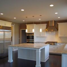 King's Court Builders, Inc.'s Custom Home - Kitchen with built-in planning desk and large island.
