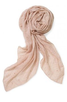 Make even the most casual outfits utterly fierce by equipping a Westwood scarf. Embody pure fashion with this beautiful gold blush scarf from Stella & Dot.