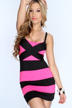 Steal the show when you show up in this stylish dress! Make a lasting impression at your next/party event, youll sure be eye catching! Pair this dress up for that special night out! Youll love it the moment you try it on! It features two tone, striped, cross strap, and tight fitted. *Thong included.