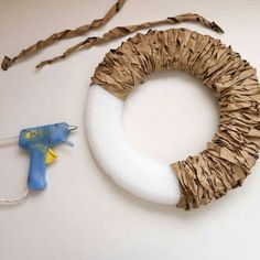 Using paper bag strips instead of twine for a wreath