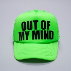 """Neon green trucker hat with snapback closure and """"Out Of My Mind"""" printed in black on front."""