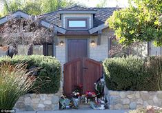 The gates to Paul Walker's home has become something of a shrine in recent days as fans wishing to pay their respects have left countless bouquets of flowers and candles.