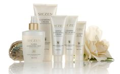 Sh'Zen PhytoExquisite products displayed beautifully with a freshly picked rose and pearly shell