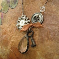 Put a button in a broken brooch if missing a stone?  Like this?