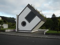 STRANGE UPSIDE DOWN HOUSE - FURNAS. Sao Miguel, AZORES ISLAND  It's an electric substation.  N 37° 46.341 W 025° 18.620