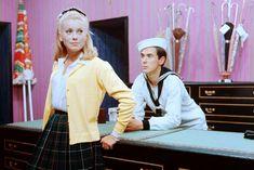 catherine deneuve in a cardigan jacket & tartan pleated skirt