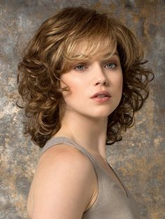 Cat by Ellen Wille is a mid-length wavy wig with a wispy bang. The hair transitions from straight on top to gentle waves and loose curls at the ends. This wig features a monofilament crown, and is ideal for a petite head size. The density of the ready-to-wear synthetic hair looks more like natural hair and requires little to no customization or thinning. Cat is part of the Ellen Wille Hair Power collection.
