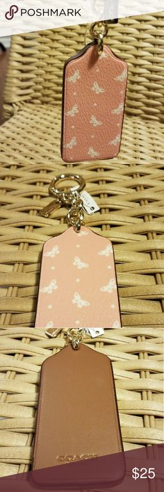 Nwt coach large butterfly tag keychain Nwt Coach large butterfly tag keychain in pink and white with gold hardware. Coach Bags