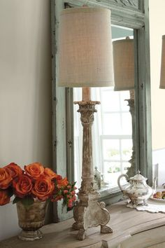 Our Candlestick Buffet Lamp has a distressed whitewash finish and a natural cotton shade, casting a warm glow when lit.