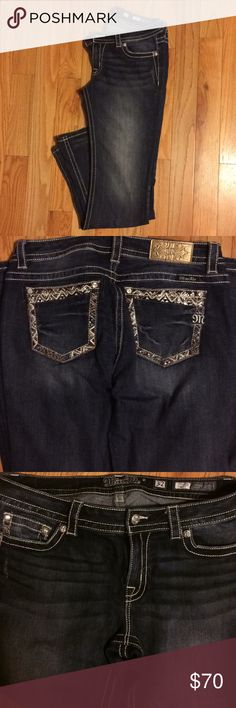 New Miss Me Signature Boot Cut Jeans Medium dark wash boot cut jean with fading and whispering.Back pockets have embellished designs with crystal stones on back pockets  On right side of waste it has golden M Patch. These have never been in dryer only air them. Silver buttons in great shape.  40in long inseam 33 These haven't been altered the bottoms have small amount of fraying. I️ bought at Macey I️ have receipt and tags. Miss Me Jeans Boot Cut