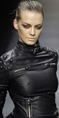 Black faux leather top with buckle at neck, multiple zippers and dome studs on shoulders.. DIY the look yourself: http://mjtrends.com/pins.php?name=zippers-for-tops