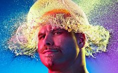 Photographer Tim Tadder created incredible water wigs for bald men using water balloons and rainbow lighting.