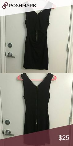 *Closet Closing* Black mini dress Cutout at the middle at the front side of the dress. Wore only once. Like new condition. Purchased from a boutique. Dresses Mini