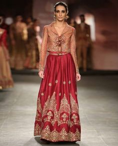 Burgundy dupian pleated lengha with golden thread embroidered motifs. Burgundy cancan attached. The set also includes old rose chanderi printed short jacket with embroidered accents. Lapel collar with tie up detailing on front. Bustier top also comes with this jacket. Wash care: Dry clean onlyDisclaimer: There might be slight variations in color as these images are from runway