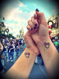 We finally got our matching tattoos and made it to Disney!!! #couplegoals #minniemouse #girlfriends #disney2015 #tattoos #matchingtattoos #coupletattoos