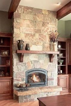 The stonework in this fireplace gives you a rustic warm look with a modern twist. an electric fireplace. by ursula - Fireplace Today Home Fireplace, Fireplace Remodel, Fireplace Mantels, Fireplace Ideas, Fireplace Stone, Simple Fireplace, Wood Mantle, Mantel Ideas, Fireplace Makeovers