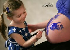 With my first pregnancy Trevor painted on Abigail... this time I think we should let Abigail paint on her baby brother/sister :) Or they could BOTH paint on my belly.... father daughter project on mommy's belly maybe? Lol It would definitely make a cute picture <3
