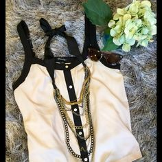 Cream and black Forever 21 tank Forever 21 black and cream polyester button-down tank. Size M, is slightly shorter in back. Super cute on! Thanks for visiting my closet! Let me know if you have any questions!  Happy shopping! Forever 21 Tops Tank Tops