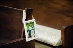 Photos from through our years together. On Wedding Pews/row end super cute
