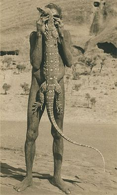 Aboriginal man holding a Ngintaka lizard, 1940 Photograph from the Mountford-Sheard collection. Photograph courtesy of the State Library of South Australia