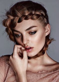 Model wears wraparound braid hairstyle